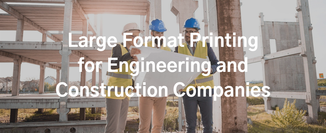 Engineering and construction professionals inspecting printed plans